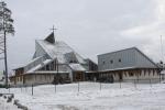Mariakirken med presteboligen til høyre